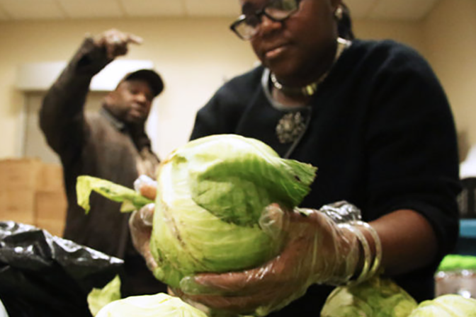 food pantry featured image -- woman with lettuce